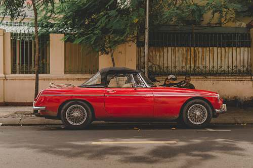automobile red convertible coupe transportation
