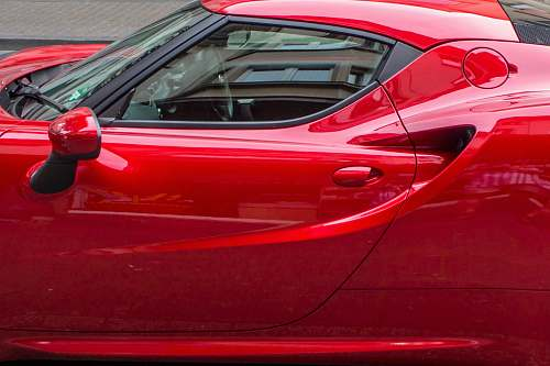 vehicle red coupe during daytime automobile