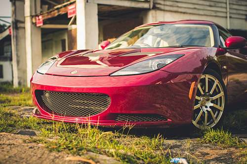 automobile red luxury car parked vehicle