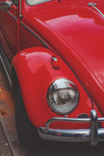 transportation red Volkswagen Beetle coupe in close-up photo vehicle