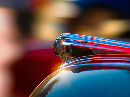 shiny selective photography of glass container hood ornament