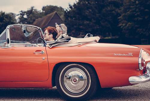 automobile two person riding vintage coupe vehicle