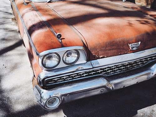 vintage vintage orange car during daytime automobile