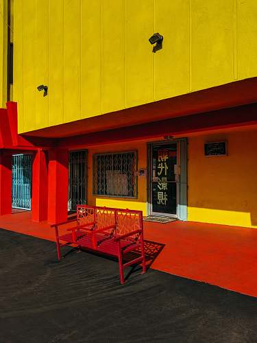 furniture red bench in front of store facade chinatown