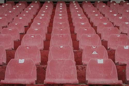 furniture rows of plastic stadium seats building