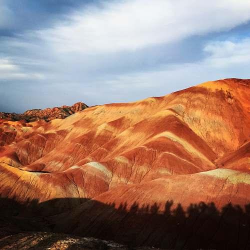 nature brown mountain during daytime soil