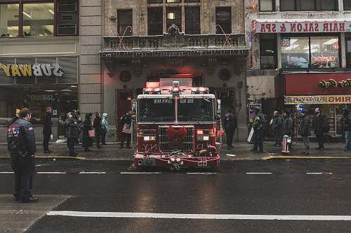 new york red and white truck near building fire engine
