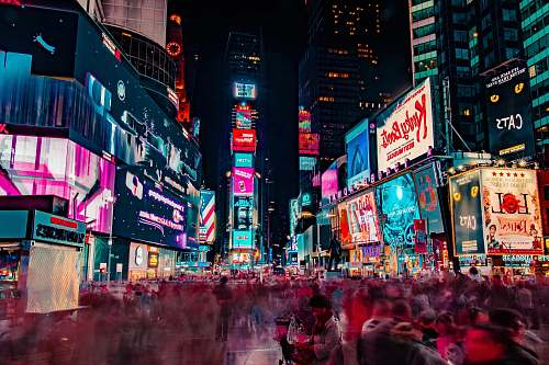 building time-lapse photography of crowd of people on New York Time square during night time night