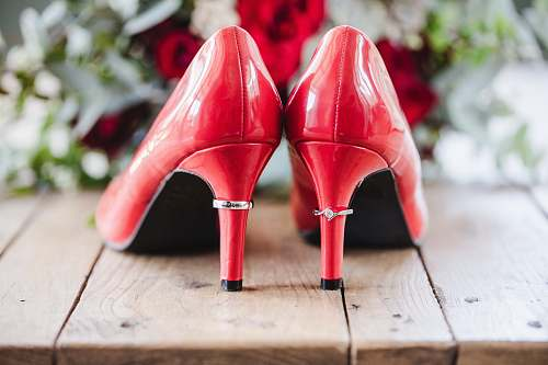 apparel pair of red patent leather heels on wooden surface footwear