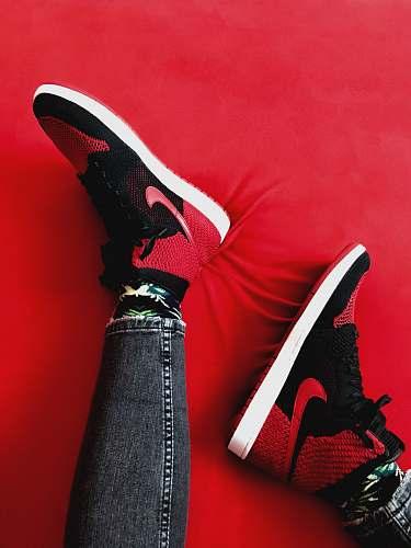 apparel person wearing Air Jordan 1 shoe s footwear