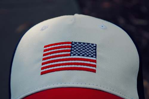 apparel white, red, and blue fitted cap hat