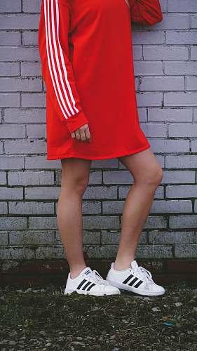 apparel woman wearing red sweater dress footwear