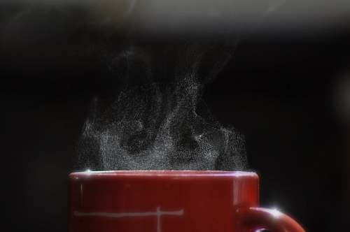 cup smoke coming out from mug filled with beverage coffee cup