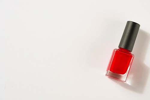 beauty photo of red nail polish lipstick