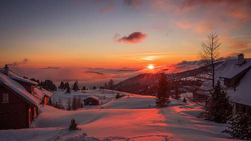 sunrise landscape photography of snow-covered village winter