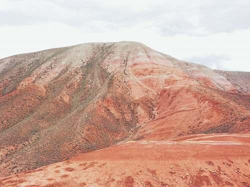 ridge close-up photography of brown mountain range during daytime mountain