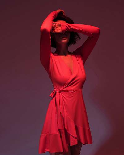 apparel woman wearing pink long-sleeved dress covering her face clothing