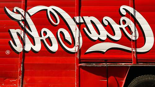 coke close-up photography of red and white Coca-Cola trailer beverage