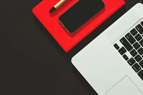 keyboard laptop beside smartphone computer keyboard