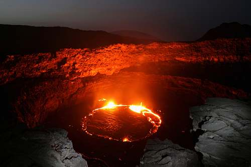 nature body of water with red flame lava