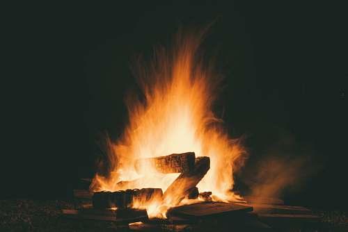 orange fire during night time burning