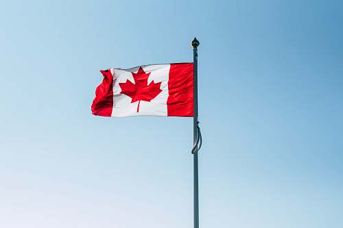 photo symbol Canada flag on pole during daytime worthing free for commercial use images