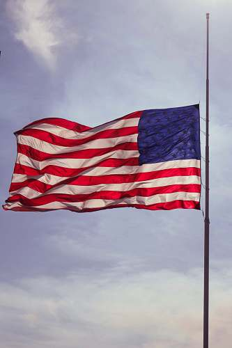 emblem U.S. flag under blue skies red