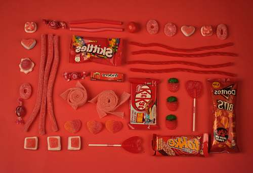 red assorted candies and chocolate pack candy