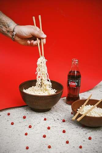 coke bowl of noodle near soda bottle coca