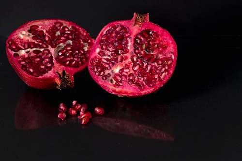 fruit focus photo of sliced red fruit pomegranate
