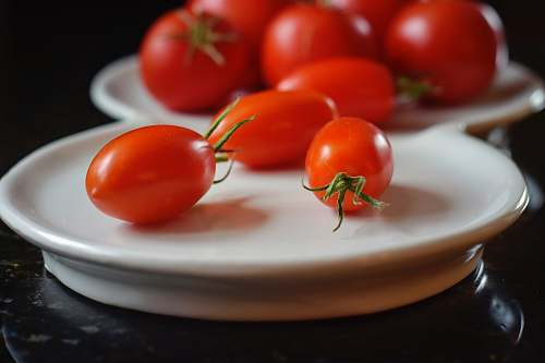 tomato red tomatoes on white ceramic plate vegetable