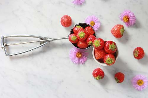 fruit strawberries on gray steel scooper strawberry