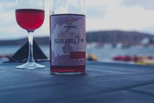 beverage Campanas red wine bottle beside wine glass drink