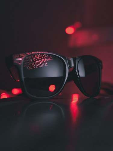 sunglasses black wayfarer sunglasses on black surface stranger things