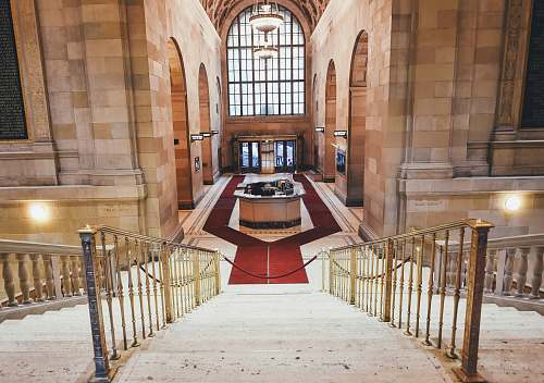 banister red carpet surrounds the reception desk aisle