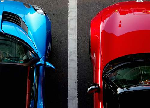 light top view photo of red and blue convertibles on asphalt road car