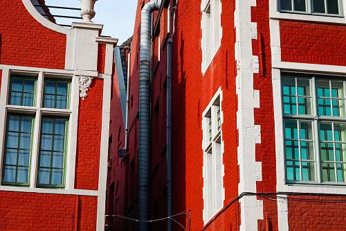window red and white painted concrete building belgium