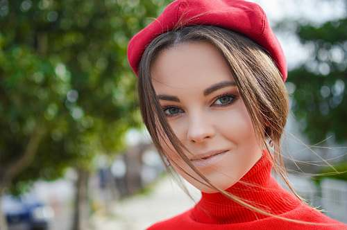 person closeup photo of woman wearing red cap people