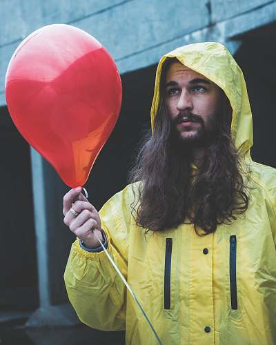 people man holding red balloon person