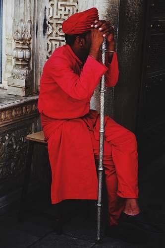clothing man sitting on stool holding walking cane apparel