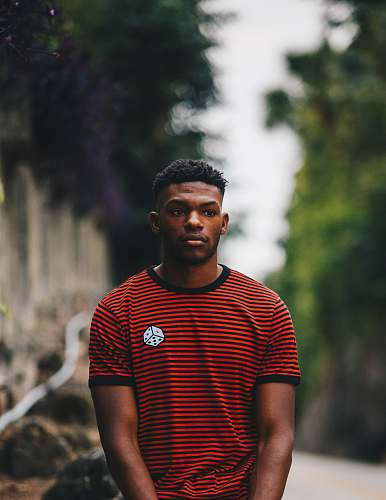 people man wearing red and black striped ringer shirt person