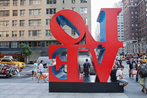 person people surrounding LOVE text statue building
