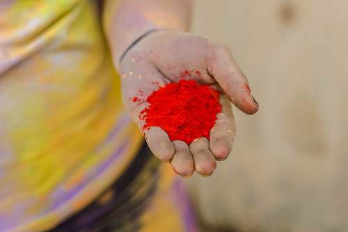 person person holding red powder finger