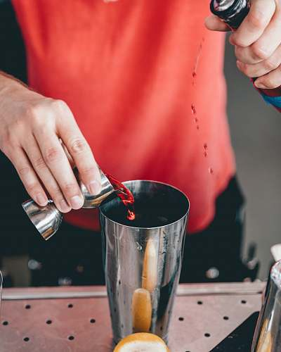 person person mixing beverage on cup finger