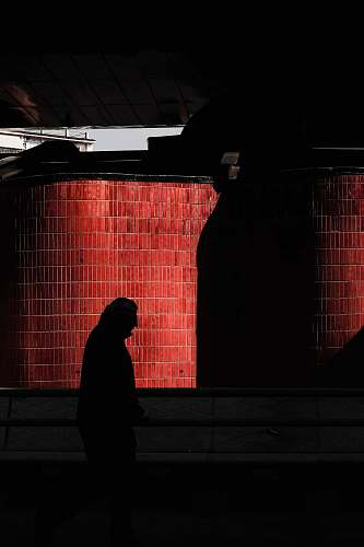 person person's silhouette on front of red wall home decor