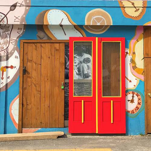 person red and brown wooden doors people