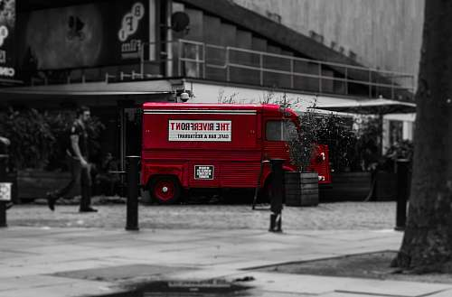 person selective color photo of red van vehicle