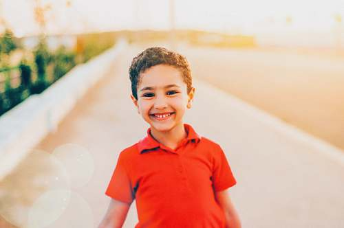 person smiling boy wearing red polo shirt people