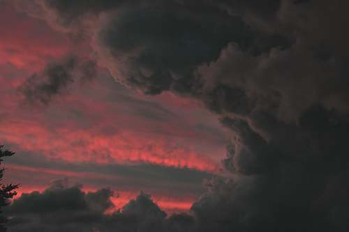 person time-lapse photography of gray clouds sky
