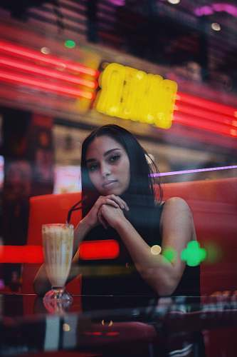 person woman in front of shake in pilsner glass people